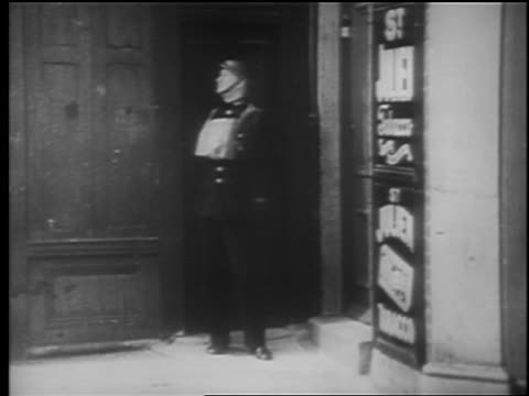 b/w 1940 soldier standing in doorway looking to side flinches steps back / london blitz / educ - london blitz stock videos & royalty-free footage