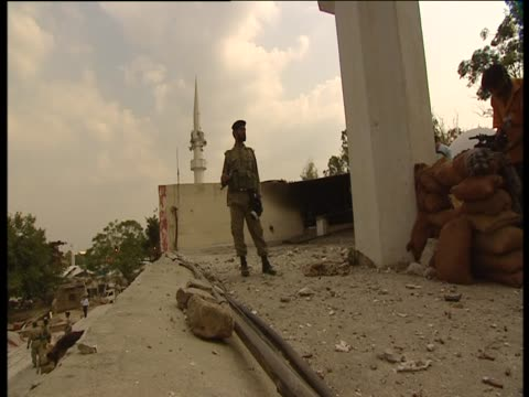 soldier stands in front of sandbag wall at the red mosque after the attacks of july 2007 - sandbag stock videos and b-roll footage