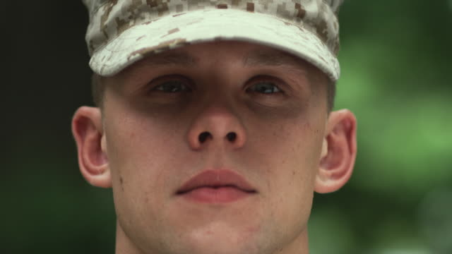 stockvideo's en b-roll-footage met sm cu portrait soldier staring looking up to stare into camera/ chicago, il - leger soldaat