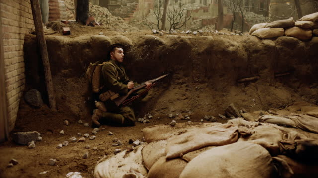 ws soldier taking cover in a trench, trying to reload - prima guerra mondiale video stock e b–roll