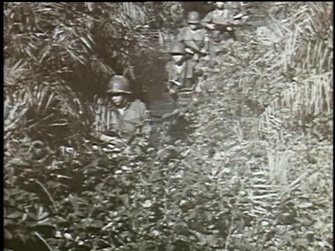 soldier talking on phone - ベトコン点の映像素材/bロール