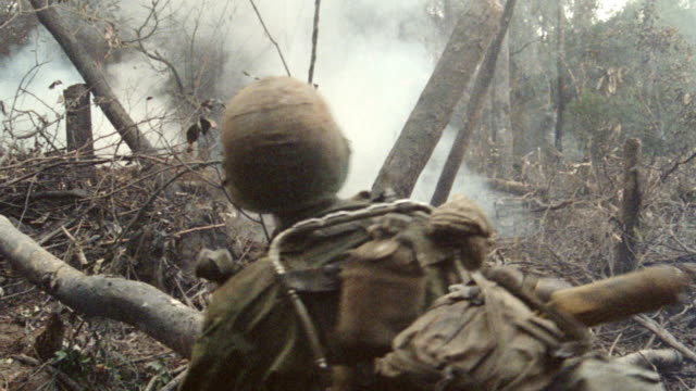 a soldier throws a grenade into a smokey jungle. - 1987 stock videos & royalty-free footage