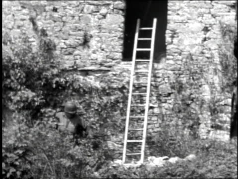 soldier throws a grenade into a window - 1944 stock videos and b-roll footage