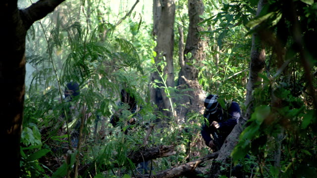 Soldier trudge into the jungle after an explosion kills insurgents in the jungle.