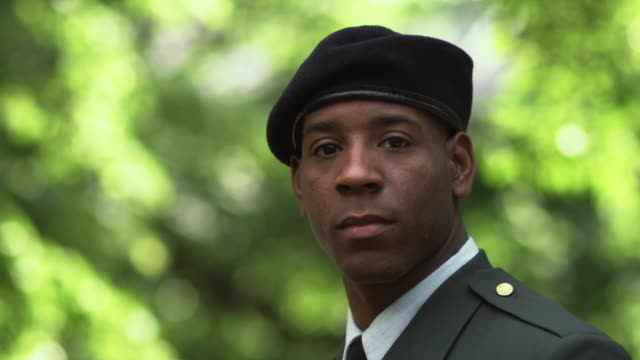 sm cu portrait soldier turning to stare into camera/ chicago, il - army soldier stock videos & royalty-free footage