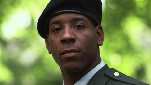 SM CU PORTRAIT Soldier turning to stare into camera/ Chicago, IL