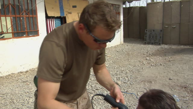 soldier using electric razor / musa qala helmand province afghanistan - electric razor stock videos and b-roll footage