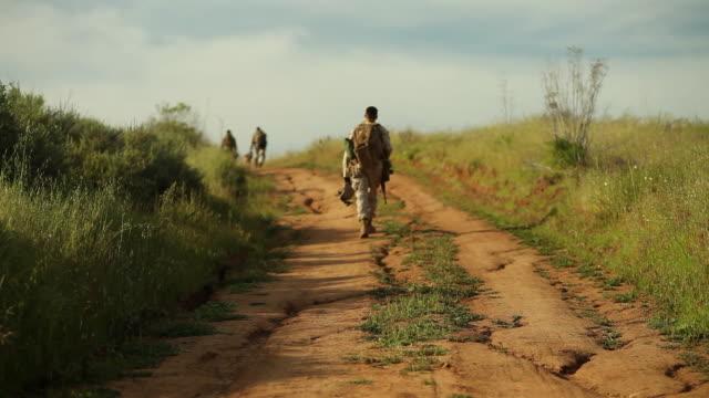 WS Soldier walking toward AUDIO / Camp Pendleton, CA, United States