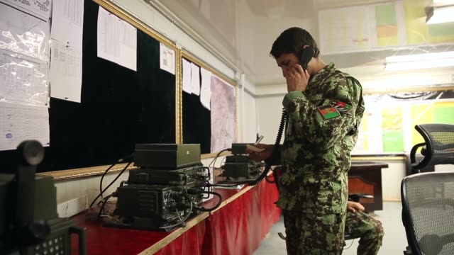 LS A soldier with the Afghan National Army communicates with units providing security for the presidential election from the tactical operations...
