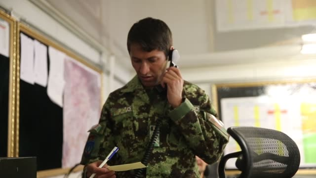 MS A soldier with the Afghan National Army communicates with units providing security for the presidential election from the tactical operations...