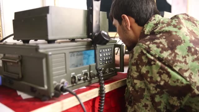 ms a soldier with the afghan national army communicates with units providing security for the presidential election from the tactical operations... - afghan national army stock videos & royalty-free footage