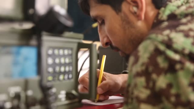 cu a soldier with the afghan national army communicates with units providing security for the presidential election from the tactical operations... - afghan national army stock videos & royalty-free footage