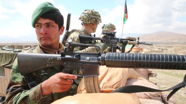 soldier with the afghan national army keeps watch alongside soldiers with the u.s. army's 2nd battalion 87th infantry regiment, 3rd brigade combat... - afghan national army stock videos & royalty-free footage
