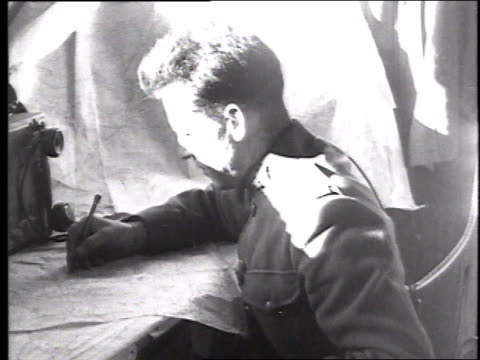 MS soldier working at a desk and examining a map / France