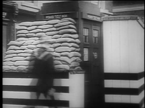 soldier/air raid warden runs to police phone booth / london blitz / educational - 1940 stock videos & royalty-free footage