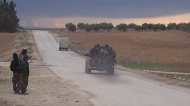 US soldiers aboard Humvee armoured vehicles have been watching from a distance as two of their allies Turkish backed forces and a Kurd Arab alliance...