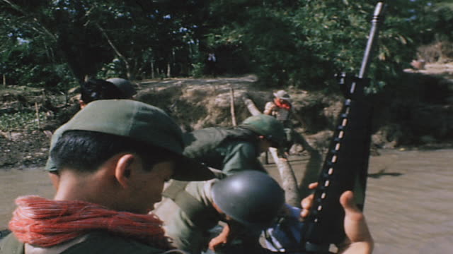 soldiers aboard pbr practicing firing m16 submachine guns on shore and on deck / vietnam - m16 stock videos & royalty-free footage