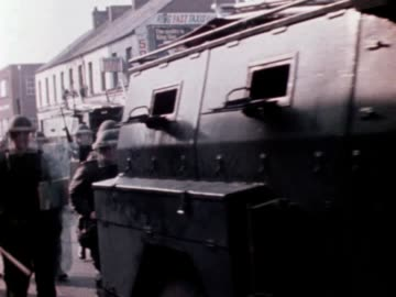 soldiers accompanied by armoured vehicles slowly move down newtownards road in belfast. - armoured vehicle stock videos & royalty-free footage