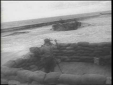 pan soldiers adjusting guns in emplacements on coast / havana / cuban missile crisis - cuban missile crisis stock videos & royalty-free footage