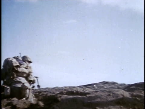 soldiers advancing / iwo jima japan - schlacht um iwojima stock-videos und b-roll-filmmaterial