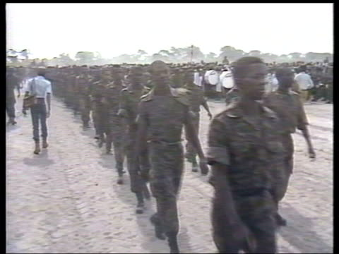 EXT Soldiers along during military parade Tank along during parade