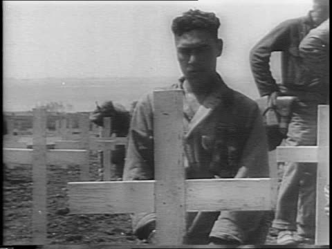 soldiers amid ruins in anzio / soldiers walking through cemetery / soldiers with bowed heads standing in front of graves / soldier standing at grave... - other stock videos & royalty-free footage