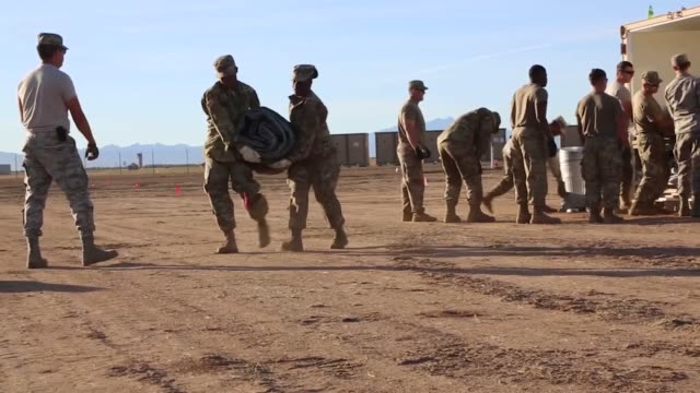 soldiers and airmen of 355 civil engineer squadron assemble framework for tents at davis-monthan air force base, arizona. sunglow city will house the... - security equipment stock videos & royalty-free footage