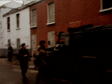 soldiers and armored cars patrol streets in falls road area 1974 - armored vehicle stock videos & royalty-free footage