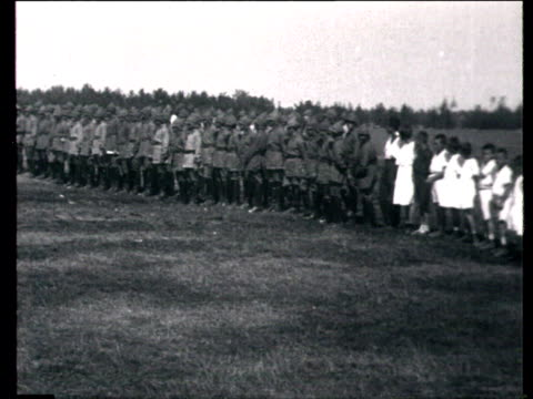 soldiers and children standing at attention officers giving papers to soldiers soldiers marching graduates of red army political battalion / russia - marciare video stock e b–roll
