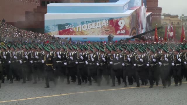 soldiers and military hardware parade across red square in moscow as the country holds its annual pomp filled celebration of the defeat of nazi... - red square stock videos & royalty-free footage