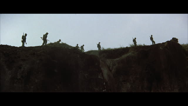ws pan soldiers and pack mules along crest of high mountain  - in silhouette stock videos & royalty-free footage