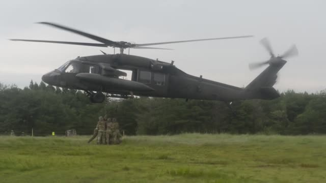 soldiers and personnel from the japan ground self defense force prepare a sling load of cargo for transportation by helicopter for orient shield 2018 - japan self defense forces stock videos and b-roll footage