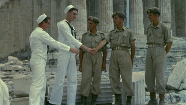1967 MS Soldiers and sailors posing, shaking hands in front of Parthenon / Athens, Greece