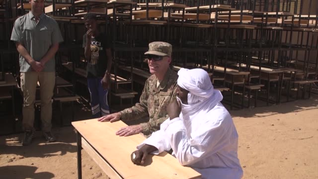 US soldiers and volunteers on Nigerien Air Base 201 Agadez Niger recycled old pallets and reuse the wood to build desks for a local school in Agadez...