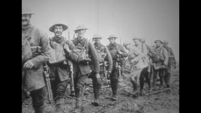 soldiers approach, pass camera as they march during world war i / military officer, possibly german, looks through spyglass during battle / note:... - german military stock videos & royalty-free footage