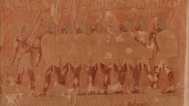 Soldiers are depicted in temple carvings in Egypt. Available in HD.