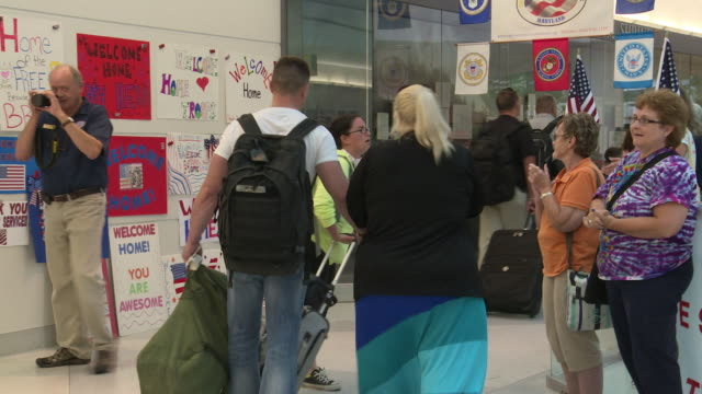 US Soldiers are Greeted at the Airport after Returning from Overseas Deployment