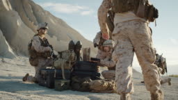 Soldiers are Using Laptop Computer for Surveillance During Military Operation in the Desert. Slow Motion.