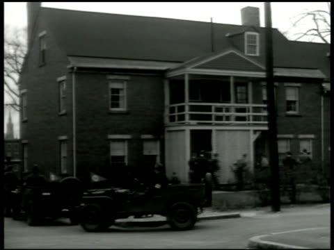 soldiers arriving at apartment in jeeps, one standing guard, others about to bust door down. n.o. flag waving on pole. people w/ numbers around neck... - concentration camp stock videos & royalty-free footage