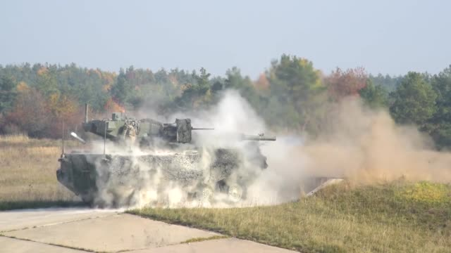 soldiers assigned to 2nd cavalry regiment conduct a live fire exercise with m1128 mobile gun system and 30mm stryker infantry carrier vehicle -... - missile stock videos & royalty-free footage