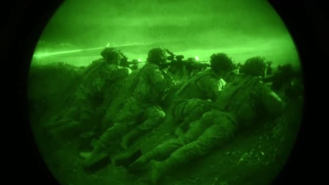 us soldiers assigned to lightning troop 3rd squadron 2d calvary regiment participate in a combined arms nighttime live fire exercise during noble... - night vision stock videos and b-roll footage