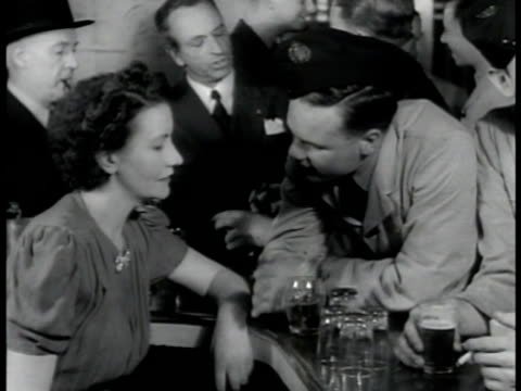rest relaxation soldiers at bar soldier talking w/ woman at crowded bar poster 'don't talk the enemy listens' ha ws female tap dancers performing on... - tap dancing stock videos & royalty-free footage