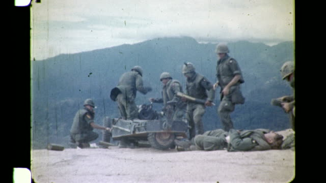 / soldiers at firebase rip chord loading and firing artillery shells - chord stock videos and b-roll footage