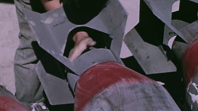 soldiers attaching tail fins to bombs and loading them aboard b-17 flying fortress - bomber plane stock videos & royalty-free footage