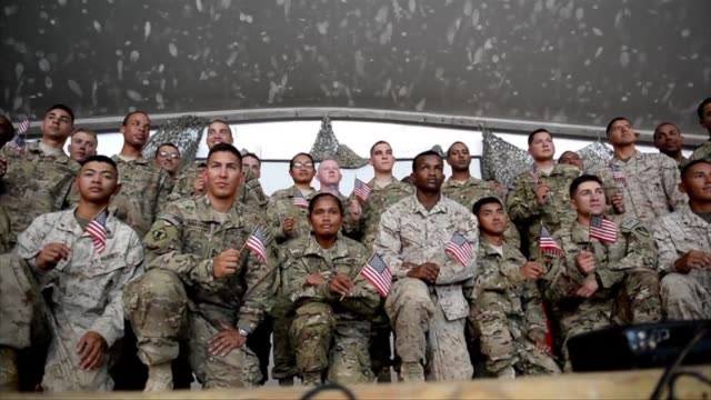 us soldiers attend a naturalisation ceremony at the us base in bagram north of kabul on thursday clean us soldiers attend a naturalisation on july 04... - bagram video stock e b–roll