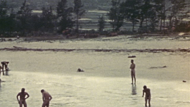 s soldiers bathing in shallow coastal waters during wwii / okinawa japan¬† - oceano pacifico video stock e b–roll