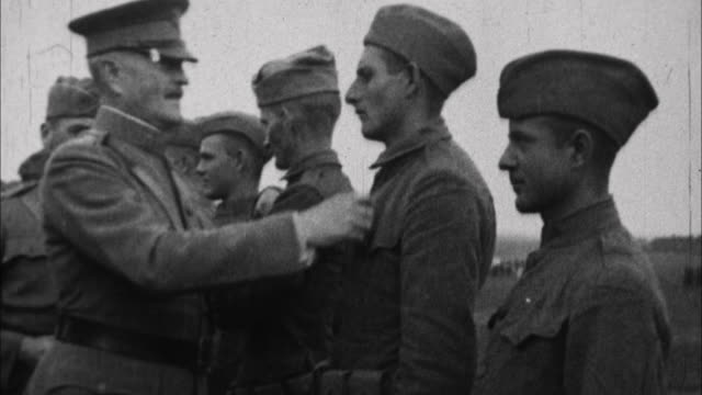 soldiers being decorated by general officer john j pershing / france - 1917 stock-videos und b-roll-filmmaterial