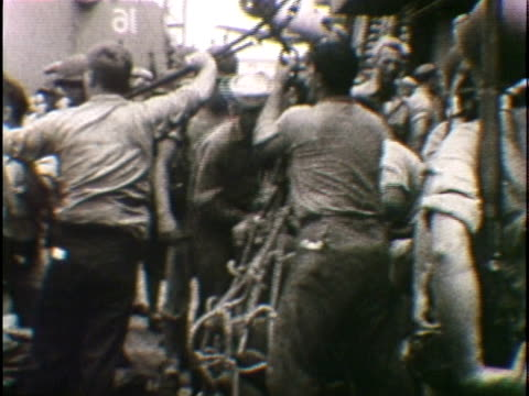 w pan soldiers being transferred in net pulled on line across warships during japanese surrender - japanese surrender stock videos and b-roll footage