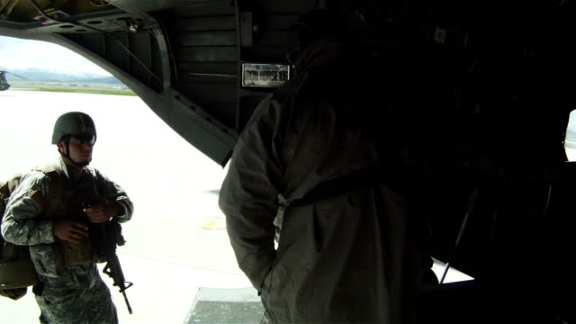 soldiers boarding a ch-47 chinook helicopter.  - military helicopter stock videos & royalty-free footage