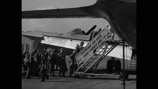 soldiers boarding military airplane on runway, tachikawa airbase, japan - carrying stock videos & royalty-free footage